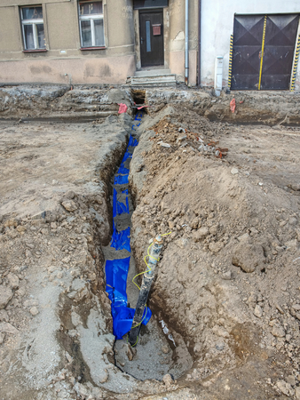 Installing new water pipes in old town street, maintenance work, dig, reparation, new water pipe.