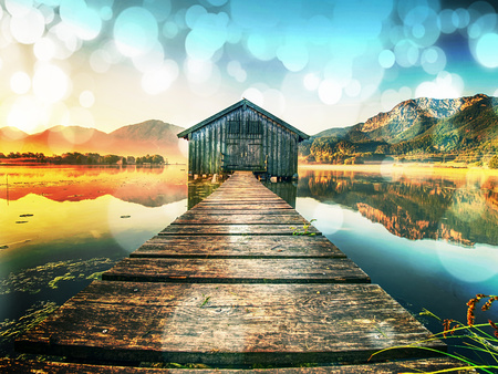 Abstract., over filtered. Old wooden ship house at scenic Lake.  Silent bay of famous mountain ake Nationalpark, Germany