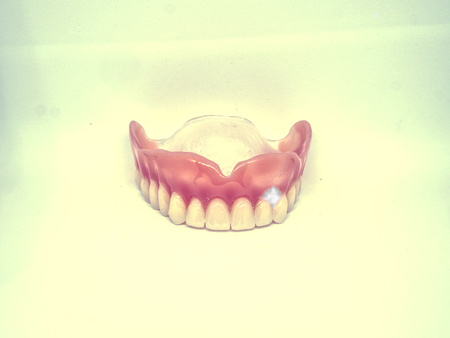 Abstract filter.  Closeup of dental prosthesis. Artificial teeth.