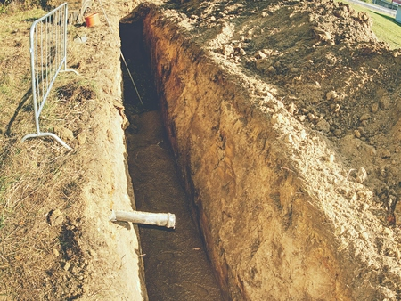 Underground pipe connector, maintenance and repair of water pipe leak in trench. Reklamní fotografie