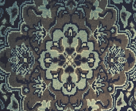 Old worn carpet, burned canvas  as floor cover.  Flowers in textile. 스톡 콘텐츠