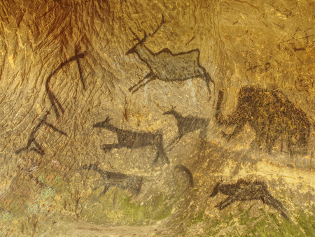 Hand-drawn cave drawings on sandstone wall. Ancient people, animals andpetroglyphs