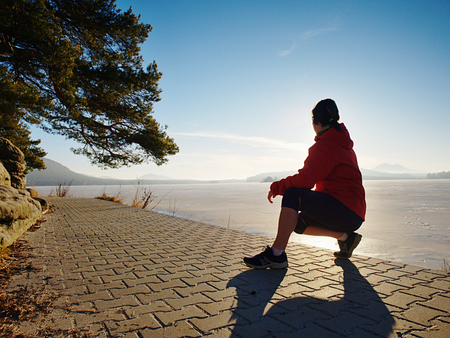 Runner woman athlete at seaside. woman fitness silhouette sunrise jogging workout wellness concept. 스톡 콘텐츠