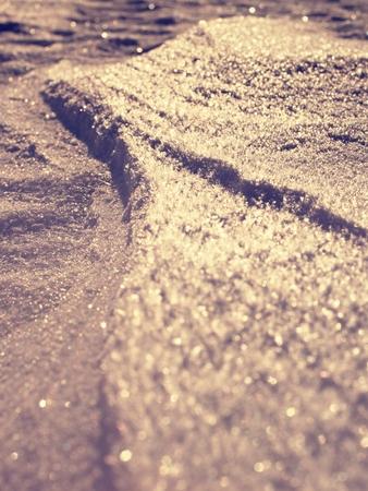 Melting Snow Spring Bokeh Snow. Shot against Setting Sun, wide open aperture. White snowflake background