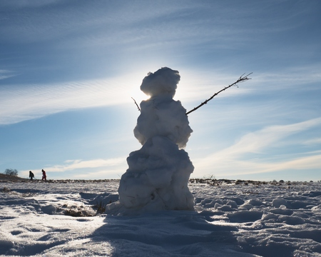 Natural icy snowman. The snow cover the landscape.  Winter time scene.