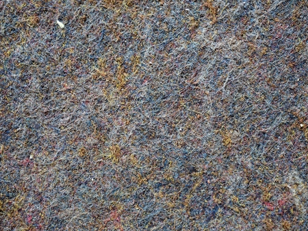 Used industrial carpet. Background from a fragment of worn ground cover