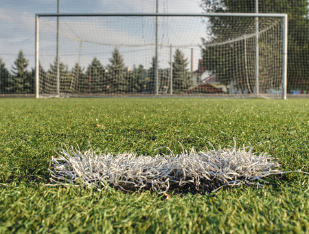 Goal keeper area. White stripe on artificial green soccer field on outdoor stadium Stock Photo