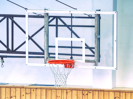 Basketball transparent backboard with basket in the gym. White background. Imagens