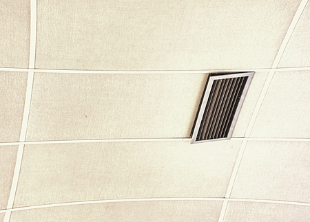 Air duct on ceiling in the mall or hospital. Air conditioner install on gypsum ceiling near ceiling lamp. Building interior concept.