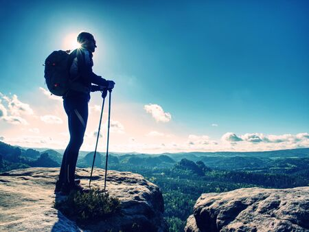 Tall man taking an excursion on a mountain. Mountain hiker looking at a far background