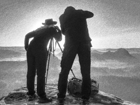 Tourists couple stay on summit and takes memory picture with camera on tripod. . Black and white dashed pencil sketch effect.
