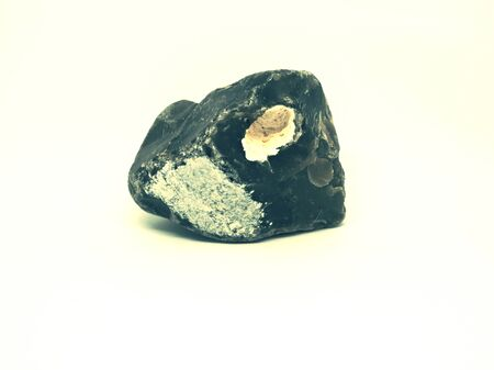 Chipped obsidian stone with cavity inside, sharp cracks flint. Isolated stone on white Imagens - 128461039