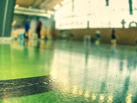 Details of lines. Gymnasium painted floor ready for balls or  run games,  dark green gym floor Imagens