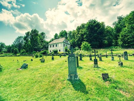 Church and graveyard in Zadni Zvonkova,  a border village ruined by the communist regime.  15th of July 2019, Zadni Zvonkova, Czech Republic. Stok Fotoğraf