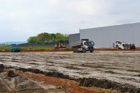Excavators are preparing terrain for new parking place at industry building.  10th of May 2019, Plasy Czech Republic.