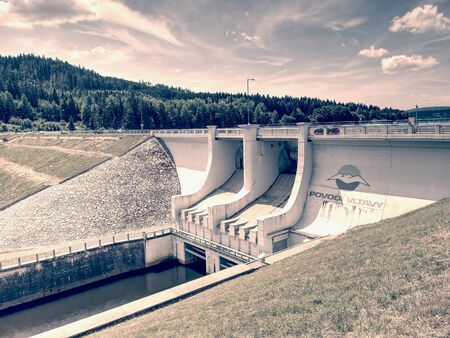 The main weir on popular Lipno lake dam on Vltava river. 17th of July 2019, Czech Republic. Povodi Vltavy - Vltava catchment basin