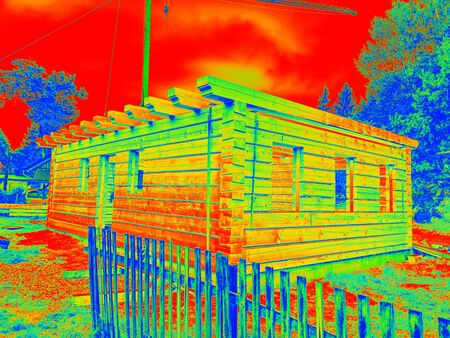 Heat Leak Infrared Detection  of beams in wooden wall. Traditional construction of timber house in thermography scan. Standard-Bild