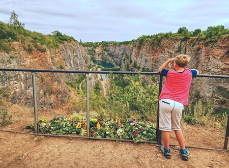 Boy stay close to place of death..  Memory to victims died at this place. Flowers at handrail above old closed mine. The memorial palce.