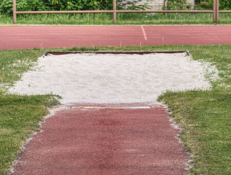 White Lane for the Long Jump. Sandy Red Retrack