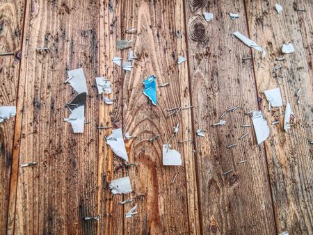 Scraps of paper on a wooden wall or  old wooden fence. Torn paper ad. cleaning ads