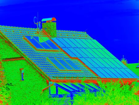 Thermal radiation scan. Panels on the roof of a country house, environmental production of solar energy