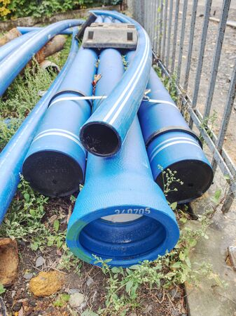 New blue pipes or tubes. Fluid conveyance. Pipeline construction. Pipes fastened with plastic tape Reklamní fotografie