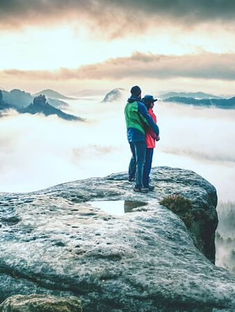 Lover women and men travel together and relax on the mountain with sunrise. Silhouette of lovers. Couple. People relationship Stock fotó