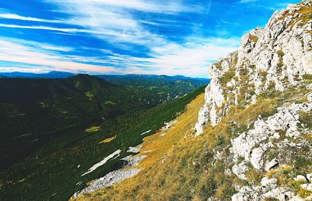 Rocky mountains with stones on ground between Alps massifes Stok Fotoğraf - 132615046