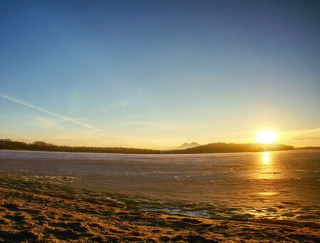 Frozen bay. Serene landscape of ice, snow, icy rock and frozen and snowy lake Reklamní fotografie