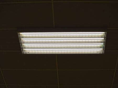 Lamps in ceiling in a stadium.   Ceiling with lighting panels. Fluorescent lamps on the modern ceiling