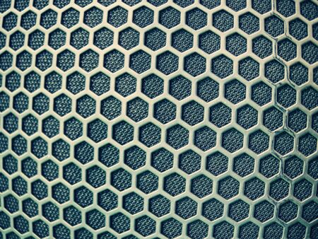 Perforated metal texture in detail, acoustic speaker grill surface Archivio Fotografico - 133516795