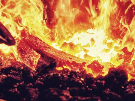 Black coal stove of blacksmith heating classic horseshoe. Blazing furnace at the blacksmith shop Фото со стока