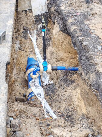 Plastic and steel pipes and valves underground. Repairing of main branch of town water delivery system Zdjęcie Seryjne