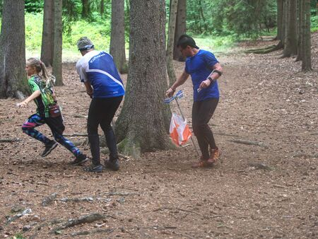 Person run hard to check point. Outdoor orienteering check point activity. Orienteering Local Race, 17th of August 2019. Mladejov, Czech Republic. Editorial