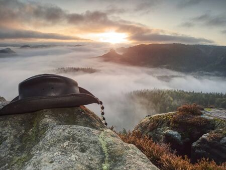 Wild west. Traditional american cowboy hat. Misty Rocky Mountains. Texas rodeo style