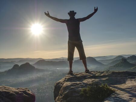 Tall Man Feel Free Over Large Valley Wearing Cowboy Hat With Arms Outstretched In Freedom Concept.