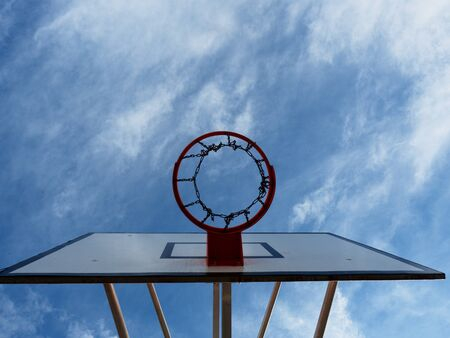 Basketball hoop and a cage with poor asphalt, sports background