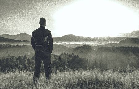 Man standing on meadow with arms akimbo. Dashed pencil sketch effect. Stock Photo