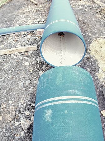 Pipes of HDPE large dimension prepared for laying on construction site. Water supply pipe