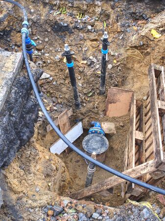 Pipe work that still under going. Black axe valve joint with HDPE tube