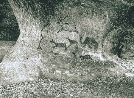 Rock paintings in a stone cave of an ancient prehistoric Neanderthal man. Mammoth. Age. Ice Age.  Dashed pencil sketch effect.