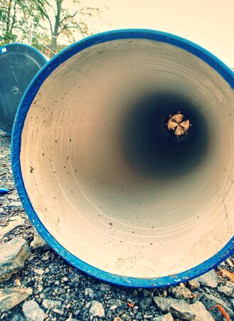 Looking inside of the large diameter HDPE pipe for potable water supply. Repairing of water delivery system in town