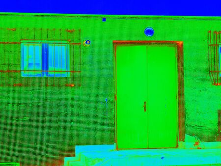 Energy waste. Traditional concrete building in thermography scan.  Infra or thermography photo