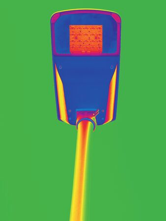 Thermovision scan of street lamp pole showing thermal radiation. Infra or thermography photo