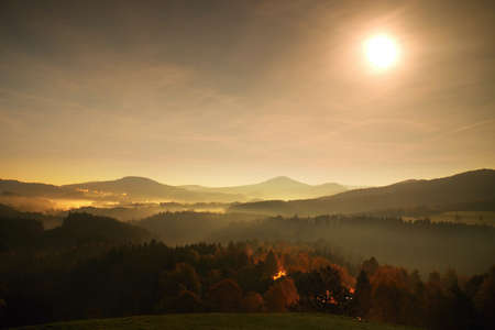Ful moon night. The fog is moving between hills and peaks of trees a makes with moon rays gentle reflections. Wonderful night