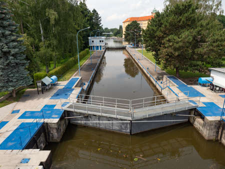 Closed river lock chamber, a device used for raising and lowering boats gate are opening. Elbe river in Podebrady town Stock Photo