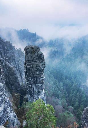 Sharp sandstone cliffs of Saxony Switzerland close Bastei bridge. Summer scene rocky mountains, Germany, Saxony, Europe.