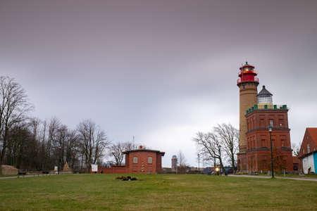 Lighthouse at Kap Arkona Island of Ruegen Germany, autumn rainy morning with dark sky