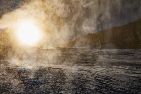 Snow cannon in winter ski resort. Snow gun spraying artificial ice crystals. Machine making snow Foto de archivo