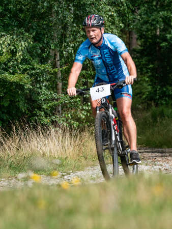 Radvanec, Czechia - 23th of August 2020. The Samuel XC triathlon event. Blue jersey rider move along the distance overcoming the descents